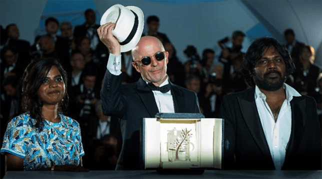 Jacques Audiard & cast winning the Palme D'Or for Dheepan, May 2015